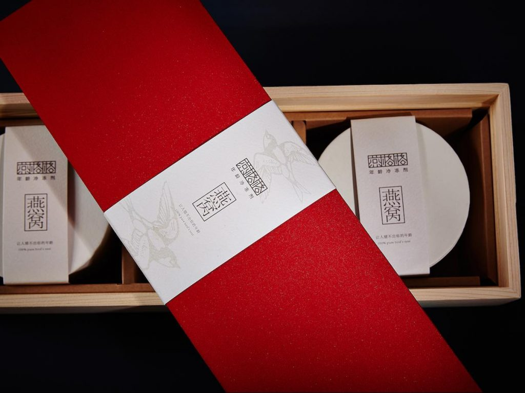 A Wooden Gift Box with a Paper Sleeve